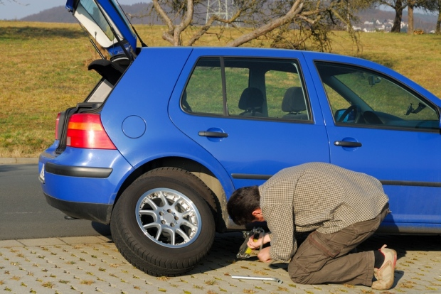 Changing a tyre is frustrating at the best of times - but it could even be dangerous on a motorway roadwork