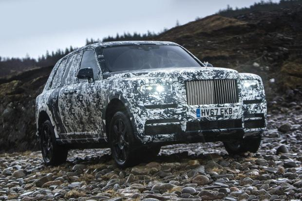 The Rolls-Royce Cullinan - seen here in prototype camouflage - is being launched later this year